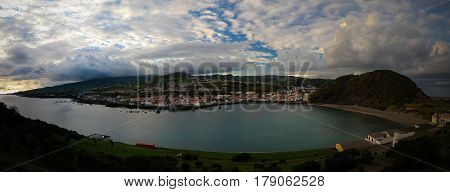 Sunset view to Horta, Porto Pim Bay and beach from mount Guia on Faial island, Azores, Portugal