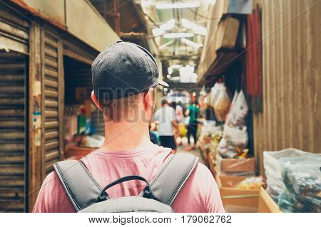 Young traveler with backpack in street market in Chinatown - Kuala Lumpur Malaysia