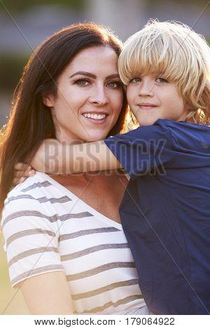 Portrait Of Loving Mother Hugging Son In Park
