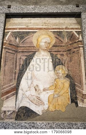 AGLIATE, ITALY - NOVEMBER 1, 2016: Agliate Brianza (Monza Lombardy Italy): interior of the medieval church of Saints Peter and Paul built from the 11th century: painting by anonymous medieval artist