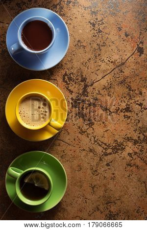 cup of coffee, cacao and tea on table background