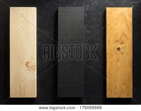 wooden board at black background texture