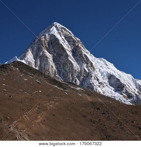 Mount Pumori and trail leading towards Kala Patthar. Scene near the Everest base camp Nepal.