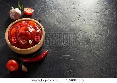 tomato sauce in bowl on black background texture