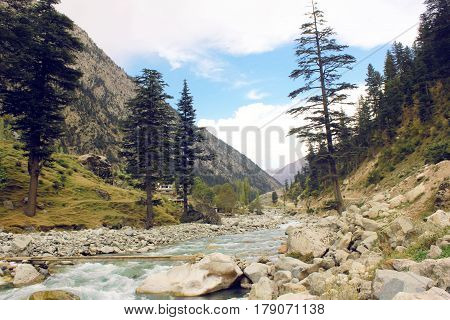 Beautiful river in the mountains with blue skys pure green water and trees in swat valley kpk Pakistan