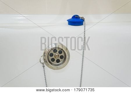 Overflow-prevention device with blue lead and chain in bathtub