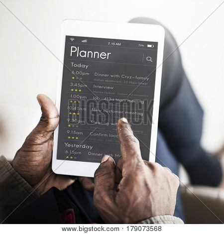 Business people checking appointment on personal organizer schedule