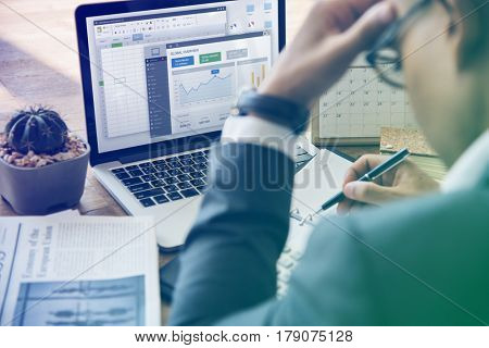 Businessman Working Writing Graph Bar On A Wooden Table