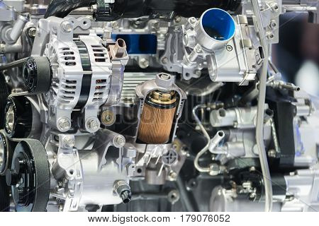 Engine oil filter cross section display inside machine motor in car.