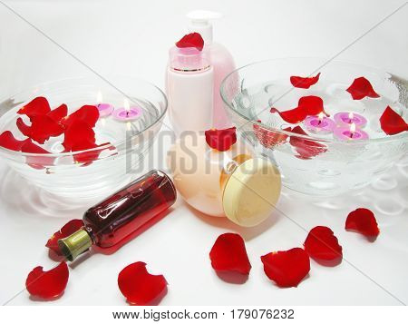 spa hair mask creme liquid soap candles towel essenses among rose petals