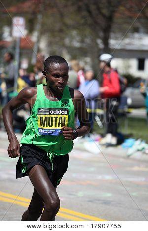 BOSTON - APRIL 18 : Geoffrey Mutai races up Heartbreak Hill during the Boston Marathon April 18, 201