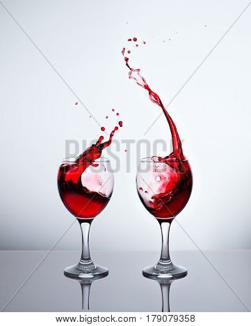 Two glasses with red wine and sprays