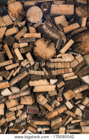 Natural wooden background, closeup of chopped firewood. Pile of wood logs. Chopped firewood on a stack.