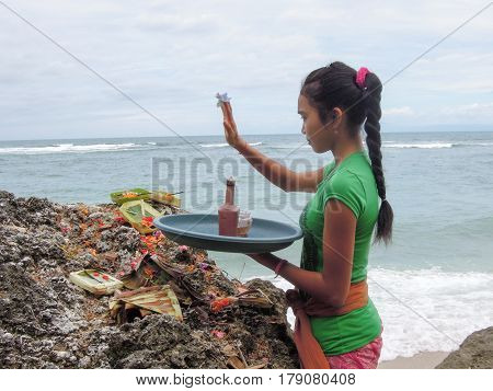 Balinese Woman Carries A Tray With Offerings To Spirits