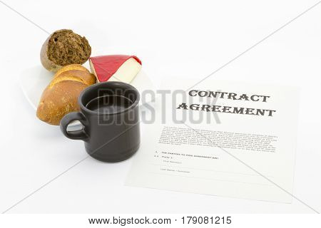 Business decision reflected in contract agreement placed with bread cheese and coffee.