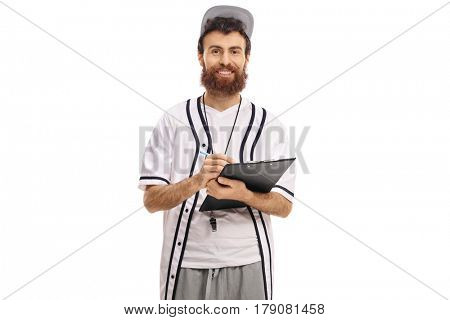 Baseball coach writing in a clipboard and looking at the camera isolated on white background