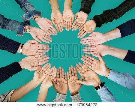 Diverse hands making circle connection