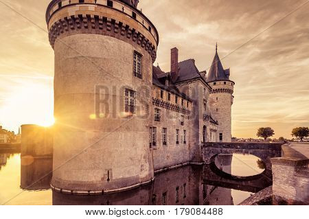 The chateau of Sully-sur-Loire at sunset, France. This castle is located in the Loire Valley, dates from the 14th century and is a prime example of medieval fortress.