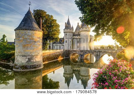 The chateau of Sully-sur-Loire in the sunlight with lens flare, France. This castle is located in the Loire Valley dates from the 14th century and is a prime example of medieval fortress.