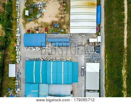 Aerial view of industrial factory among the farm land