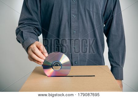guy putting a cd into a ballot box: electronic voting, the wrong way.