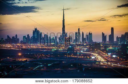 Dubai skyline at sunset, colored dramatic sky