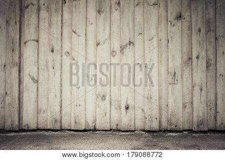 Old Wooden Wall And Asphalt Pavement
