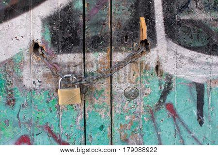 Padlock On Graffiti Painted Wall