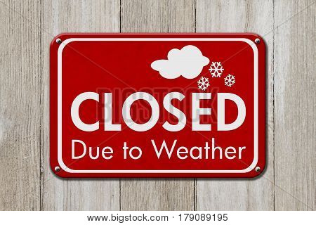 Closed due to weather sign A red sign with text Closed due to weather on weathered wood 3D Illustration