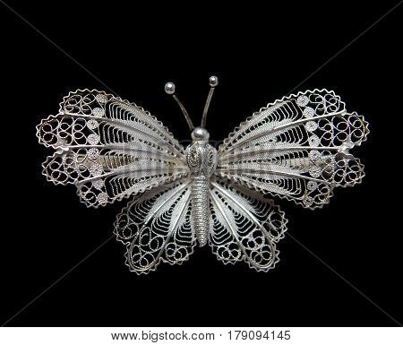 Vintage filigree silver brooch Butterfly isolated on black background