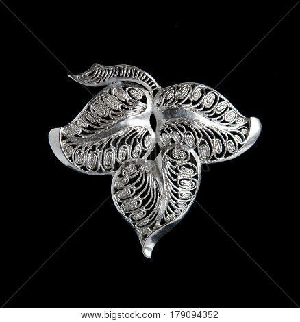 Vintage filigree silver brooch Leaf isolated on black background