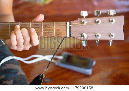 Musician playing guitar Close up guitar. Man holding his guitar.