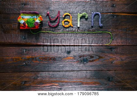 Knit shop background with title 'Yarn' and cozy sweater holding needles and yarn ball