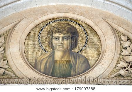 ROME, ITALY - SEPTEMBER 05: Saint John the Apostle, mosaic in the basilica of Saint Paul Outside the Walls, Rome, Italy on September 05, 2016.
