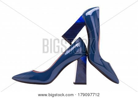Blue patent leather shoes on the heel.