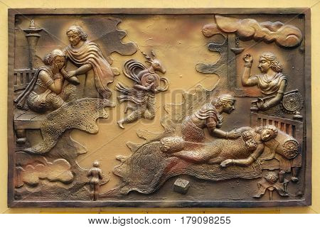 KOLKATA,INDIA - FEBRUARY 09, 2016: Hari-naigamesin removes the foetus from Devanandas wom and lodges in the tomb of queen Trisala, bass relief on the wall of Jain Temple in Kolkata, India