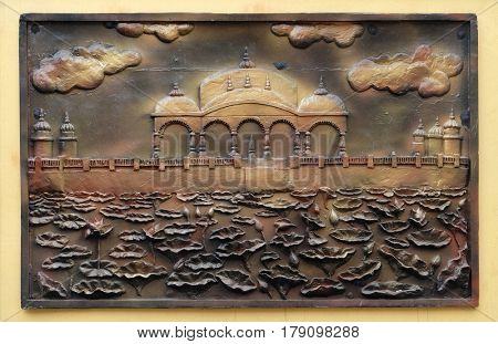 KOLKATA,INDIA - FEBRUARY 09, 2016: Jalmandir-Pavapuri Bihar - the place where Lord attains Nirvan, Street bass relief on the wall of Jain Temple (also called Parshwanath Temple) in Kolkata, India
