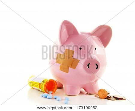 Bandaged piggy bank with pills and money