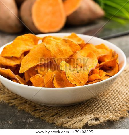 Hearty sweet potato crisps served in a bowl.