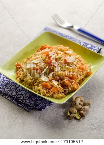 risotto with fresh tomatoes and pistachio nut, selective focus
