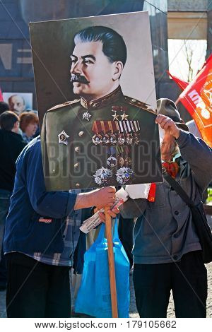 Volgograd Russia - May 01 2011: People with portrait of the leader of the USSR Joseph Stalin take part in the May day demonstration in Volgograd