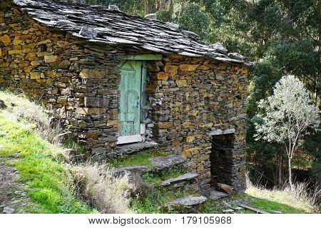 An abandoned old shale house in a rural portuguese area.