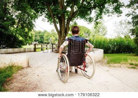 Senior woman in wheelchair, enjoying a day in the park