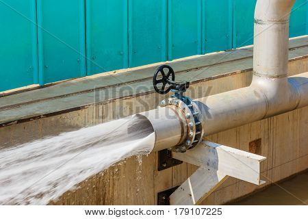 Water gushing out of the pipe for cleaning pipe after installation