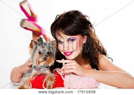 girl in pink with small dog on white