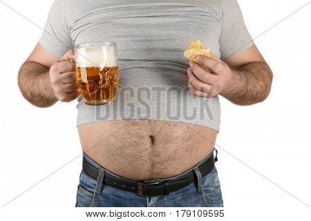 Man with big belly holding glass of beer and snack on white background
