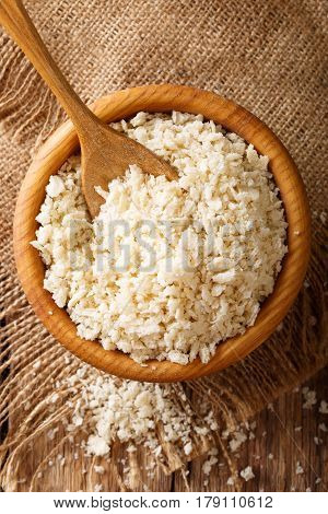 Japanese Panko Crumbs For Breading In A Bowl On A Table Close-up. Vertical Top View