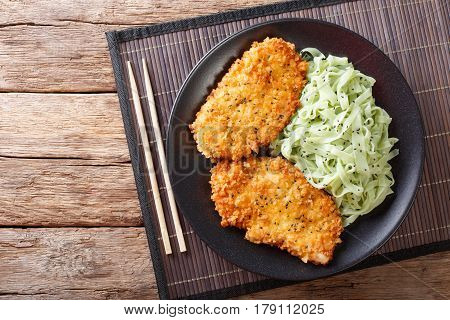 Japanese Chicken Cutlets In Breadcrumbs Panko And Noodles With Green Tea Macha. Horizontal Top View