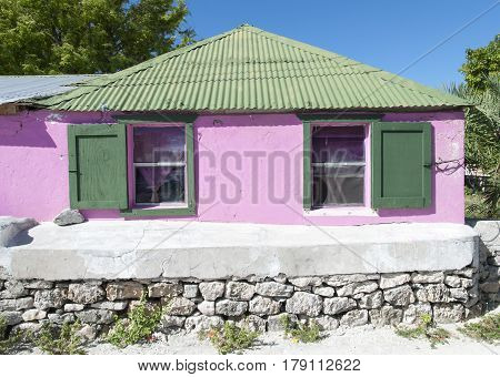The characteristic pink color house in Cockburn Town on Grand Turk Island (Turks & Caicos).