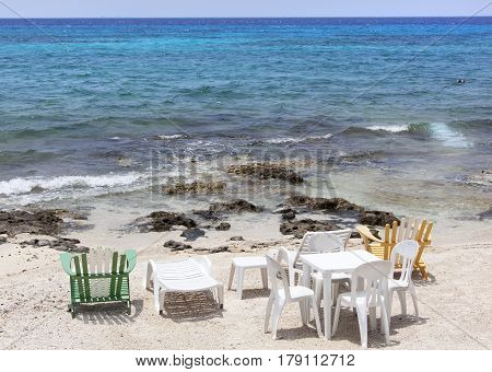 Chairs and the table on San Miguel town beach (Cozumel island Mexico).